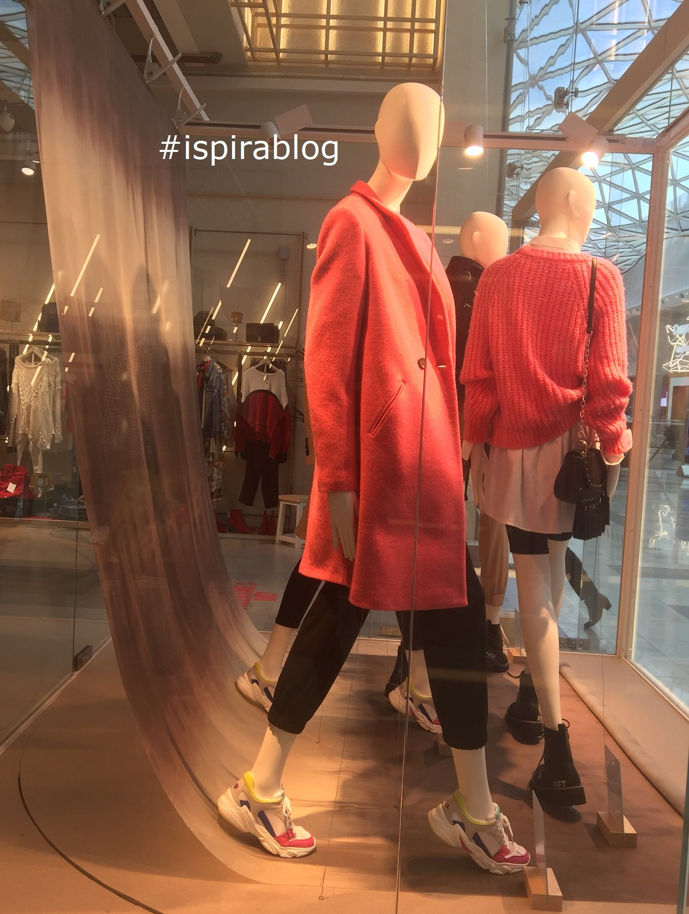 8f727a0bab2 ... Stradivarius - London - Spring Preview 2019 - Womenswear Collection -  pink coat and sweater and black trousers with black small handbag