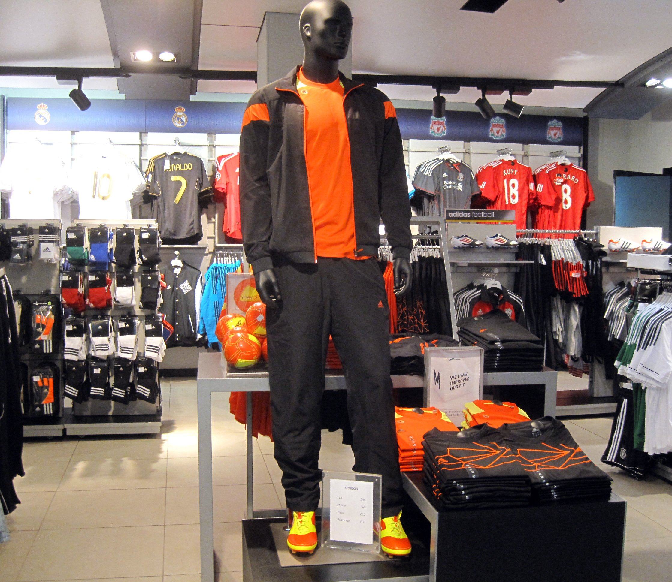 BUCHAREST, ROMANIA - JULY 18, 2014: Adidas Shoes In Shoe Store Display. Is a German multinational corporation that designs and manufactures sports clothing